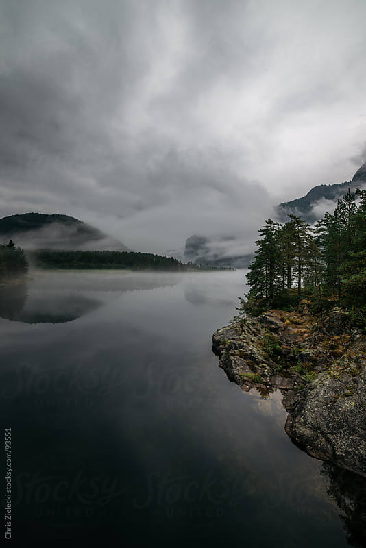 Misty lake in the mountains by Chris Zielecki for Stocksy United