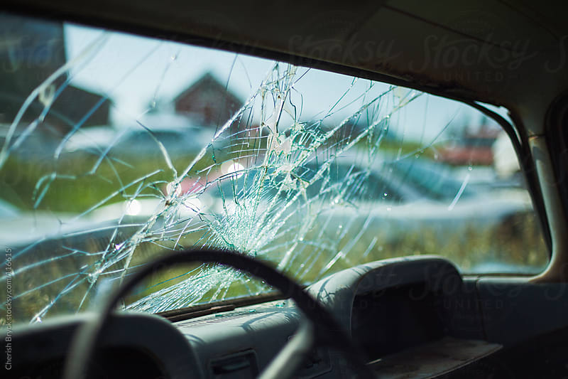 A broken windshield of a car. by Cherish Bryck for Stocksy United