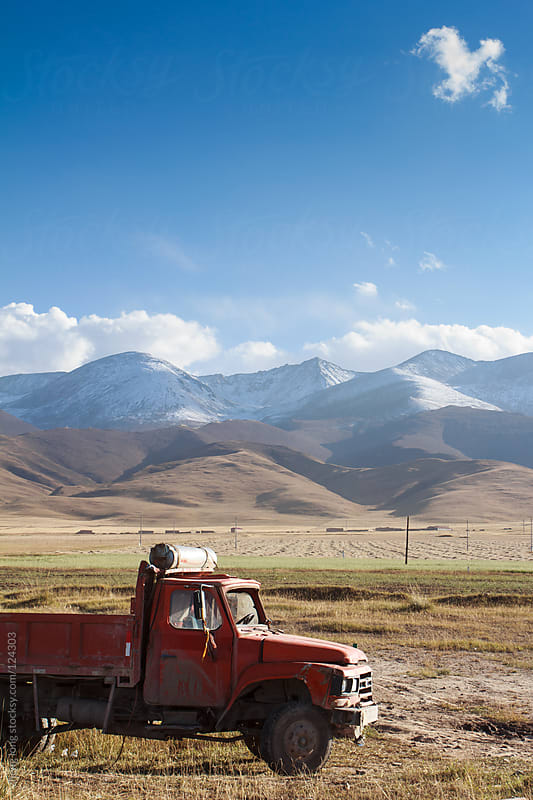 old truck in the grassland by zheng long for Stocksy United