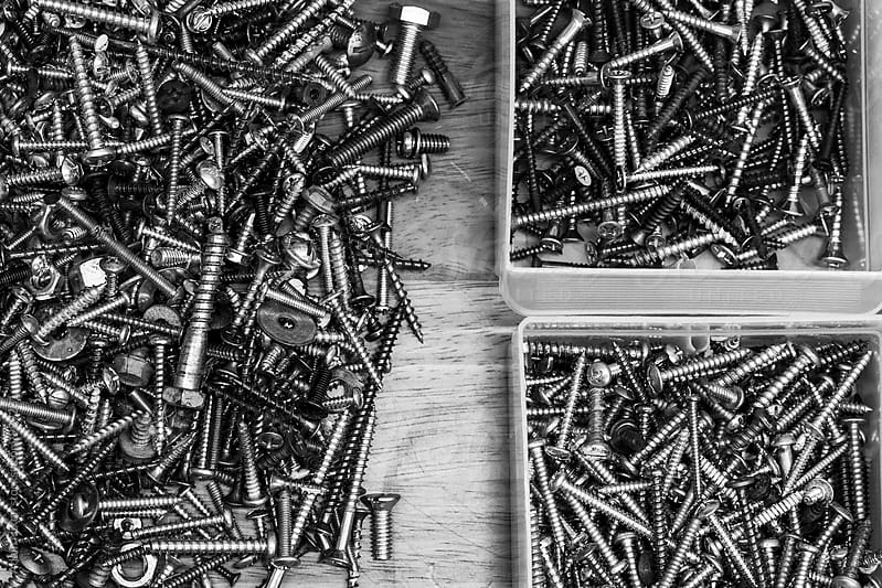 Organizing fasteners in the workshop by Adam Nixon for Stocksy United