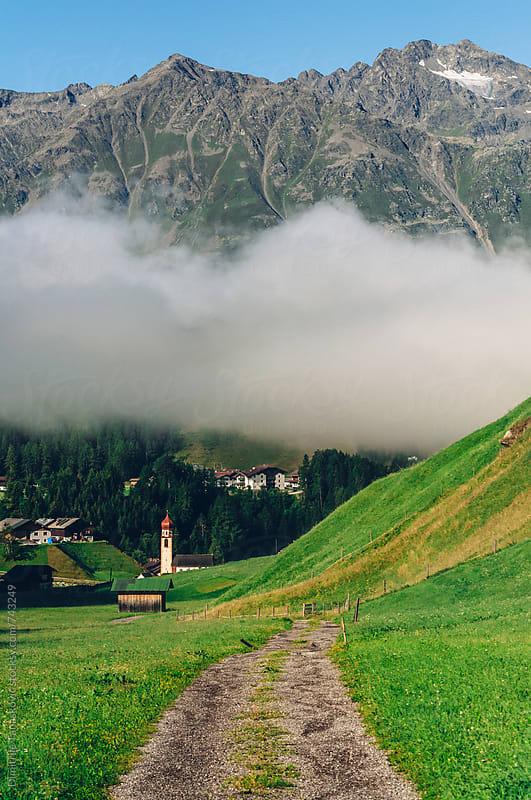 Beautiful morning scene in Austrian Alps by Dimitrije Tanaskovic for Stocksy United