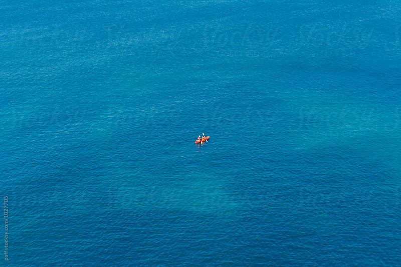 People in kayak in the middle of the Pacific Ocean in California by paff for Stocksy United