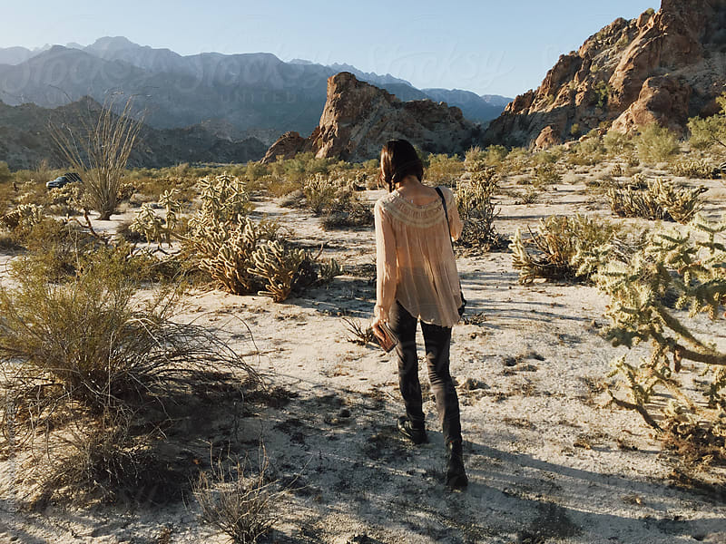Bohemian Woman Wanders Desert in Mexico by Kevin Russ for Stocksy United