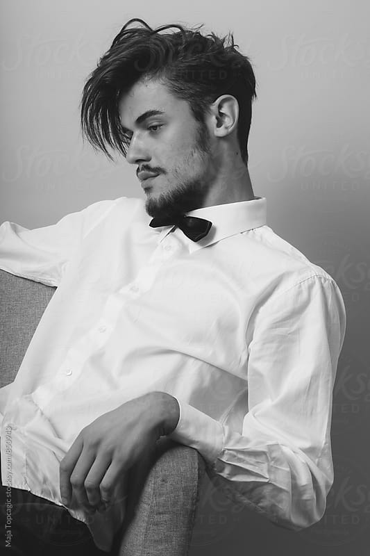 Handsome young man in studio by Maja Topcagic for Stocksy United