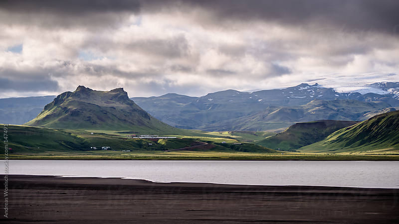 Summer landscape with lake and Mountains in Iceland by Andreas Wonisch for Stocksy United