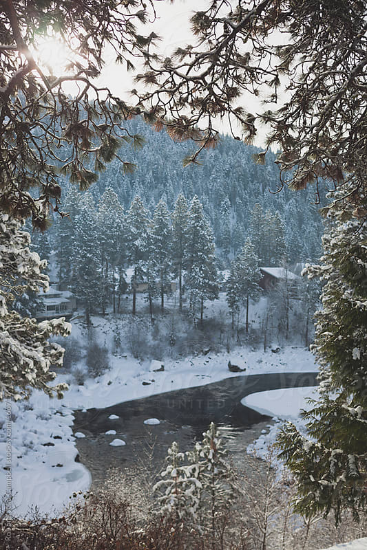 landscape of snowy river in winter by Rob and Julia Campbell for Stocksy United