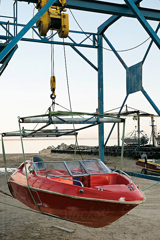Close-up of red boat hanging in dock by Danil Nevsky for Stocksy United