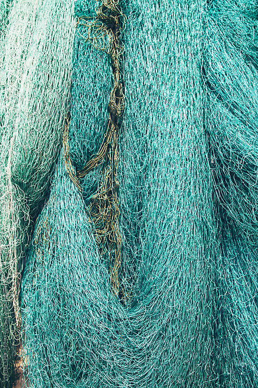 Turquoise Fishing Net  by VISUALSPECTRUM for Stocksy United