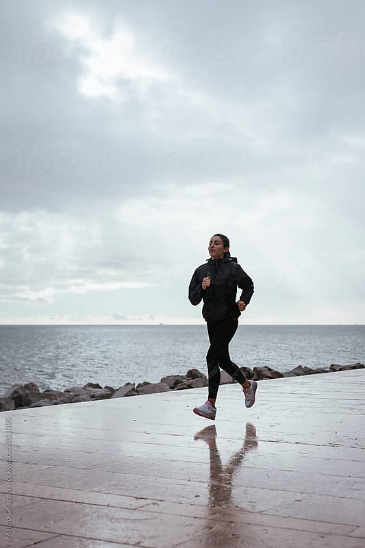 Woman runs outdoor by Mauro Grigollo for Stocksy United