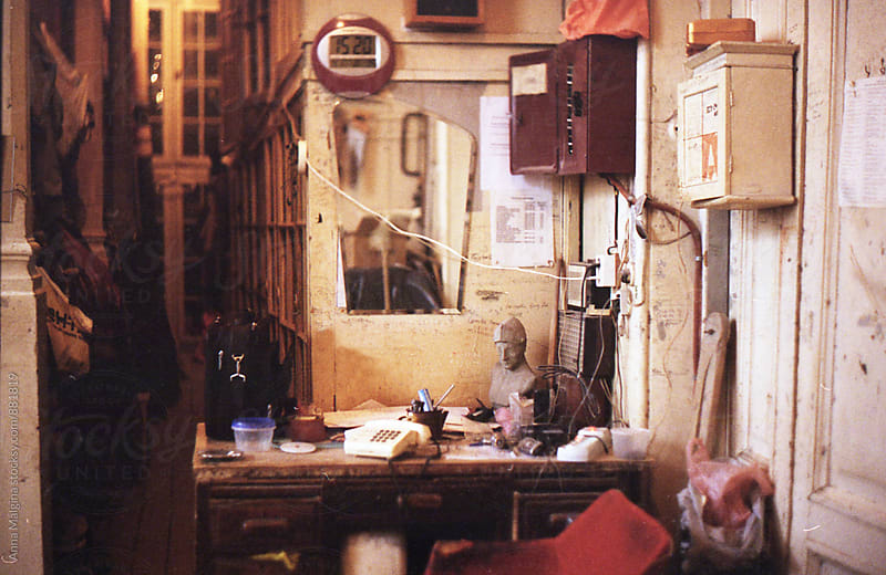 A film photo of chaotic table in the old artistic studio by Anna Malgina for Stocksy United