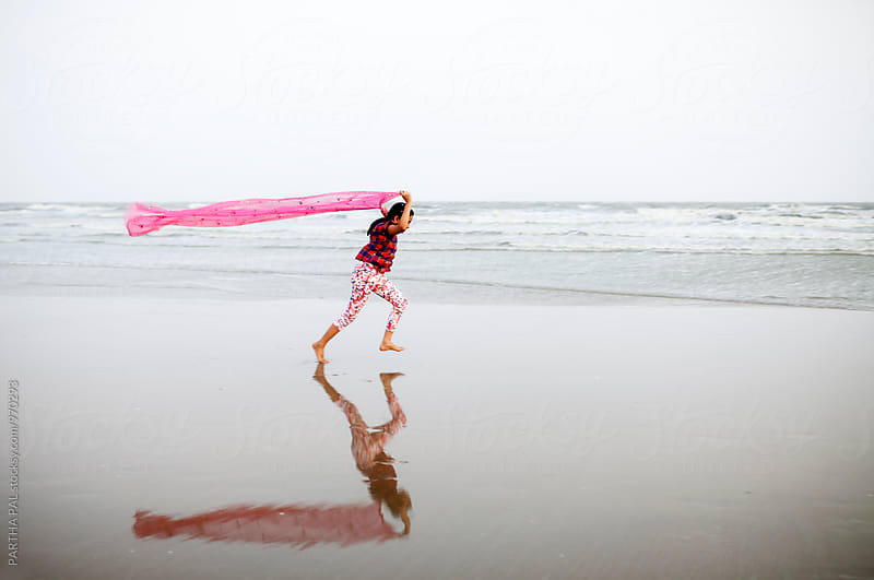 A girl enjoying breeze in sea beach by PARTHA PAL for Stocksy United