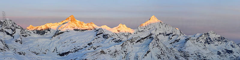 Mountains of Switzerland: Panorama with Weisshorn from Gornergrat at Sunrise by Peter Wey for Stocksy United