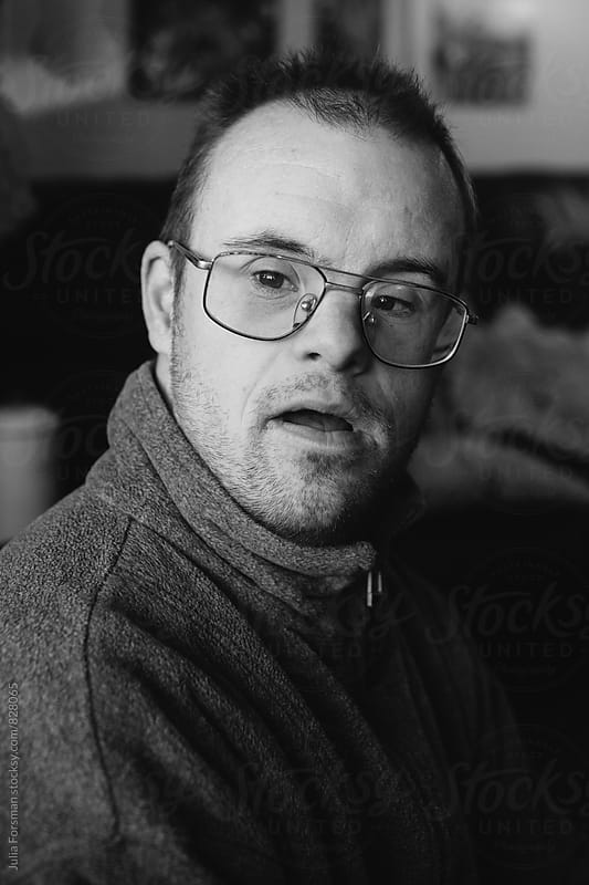 Black and white portrait of a middle aged man with special needs. by Julia Forsman for Stocksy United