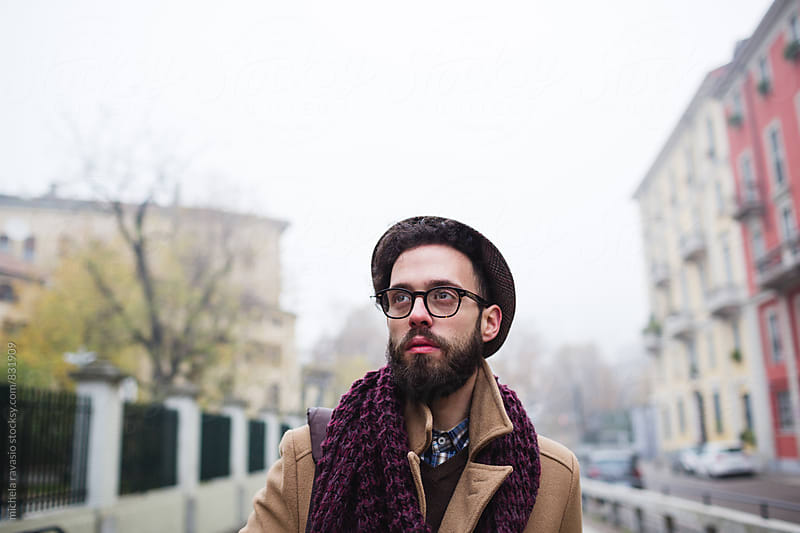Portrait of young man in the city on a cold day by michela ravasio for Stocksy United
