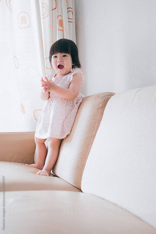 Asian baby girl by Xunbin Pan for Stocksy United