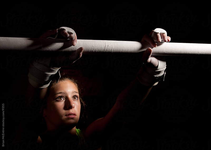 Trepidation: Look of Concentration as Gymnast Addresses Bars by Brian McEntire for Stocksy United
