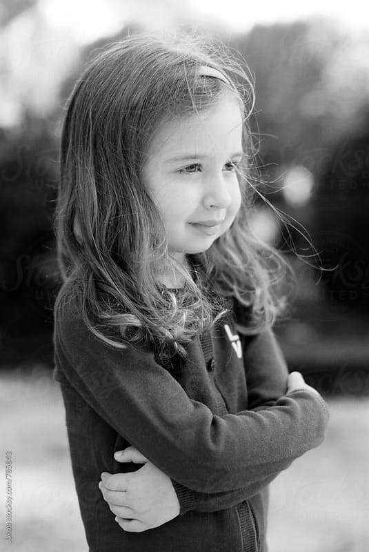 Black and white profile portrait of a beautiful young girl by Jakob for Stocksy United
