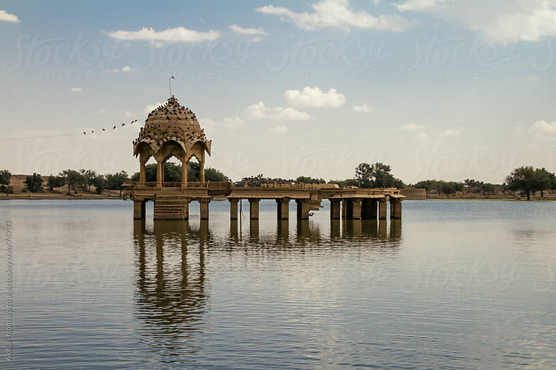 Indian temple on a lake by Leander Nardin for Stocksy United