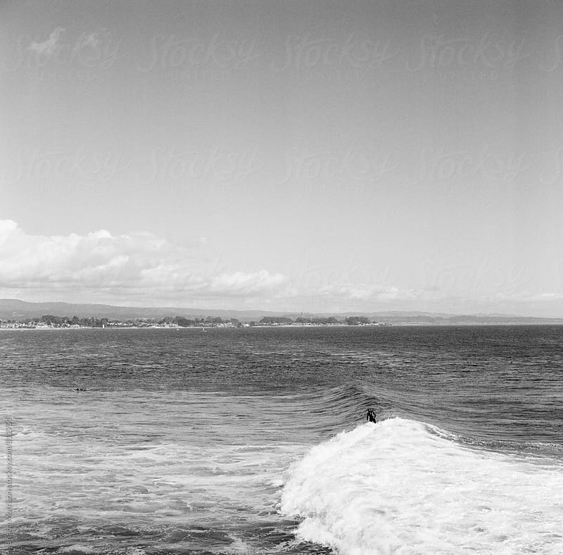 Lone surfer at end of his wave at Steamers Lane by Briana Morrison for Stocksy United