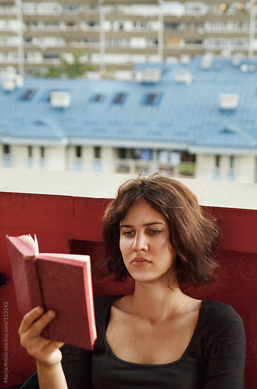 Girl is reading a book by Marija Anicic for Stocksy United