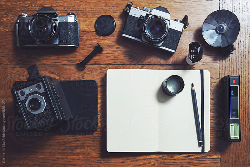 Film cameras and notebooks... by Catherine MacBride for Stocksy United