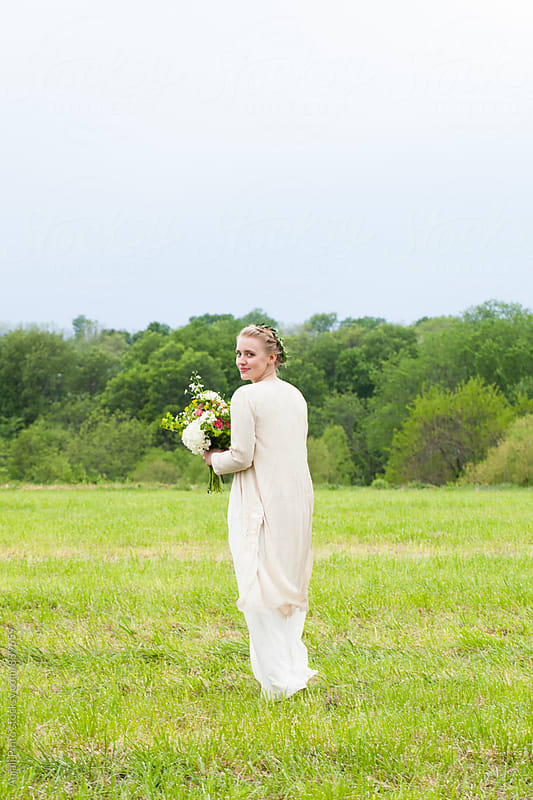 Outdoor Bride Walking  by Anjali Pinto for Stocksy United