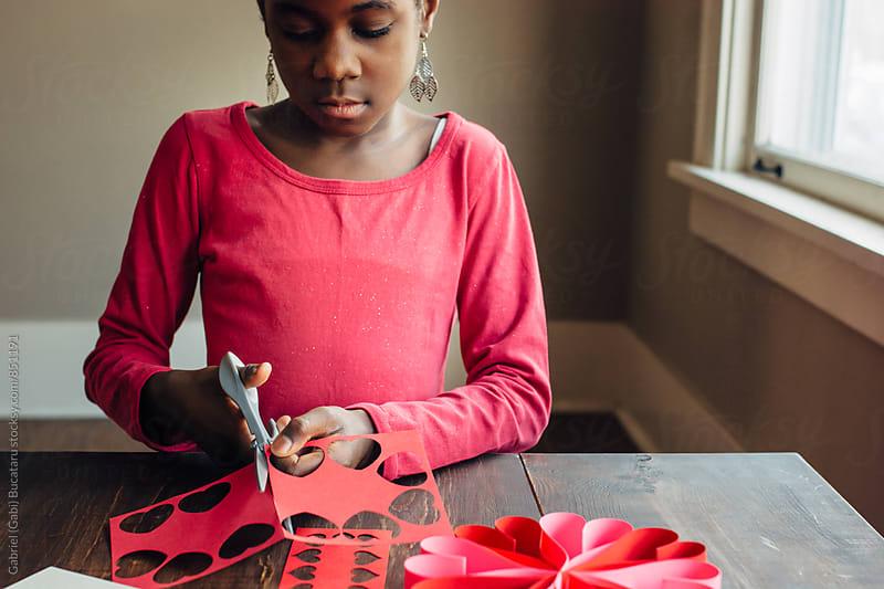 African American girl working on Valentines crafts by Gabriel (Gabi) Bucataru for Stocksy United