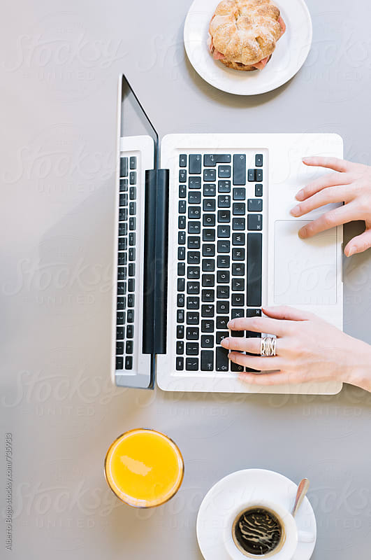 Business woman working with laptop at the cafe by Alberto Bogo for Stocksy United