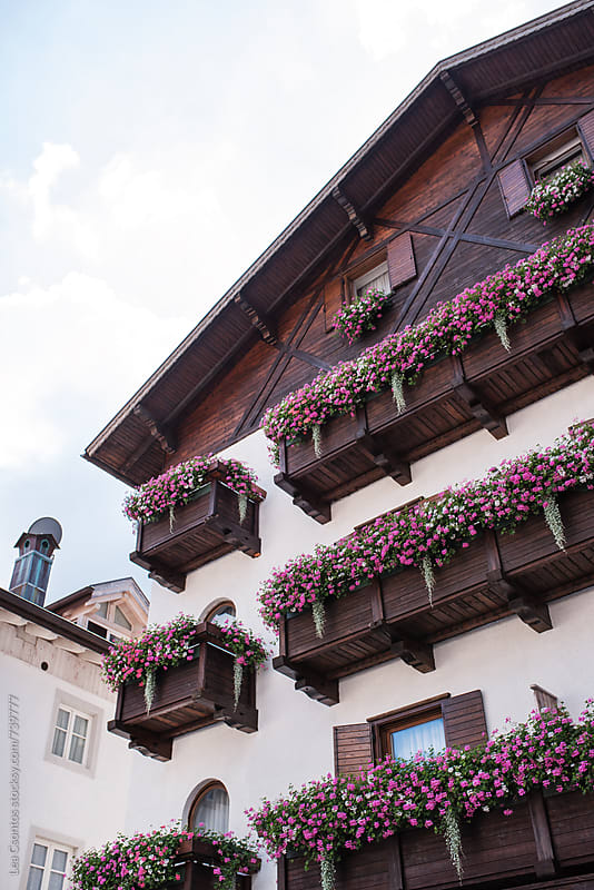 A typical, nice motel in the Alps with balconies and flowers by Lea Csontos for Stocksy United