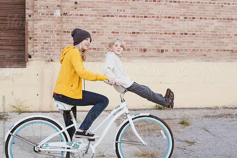 sibling fun by Rebecca Rockwood for Stocksy United