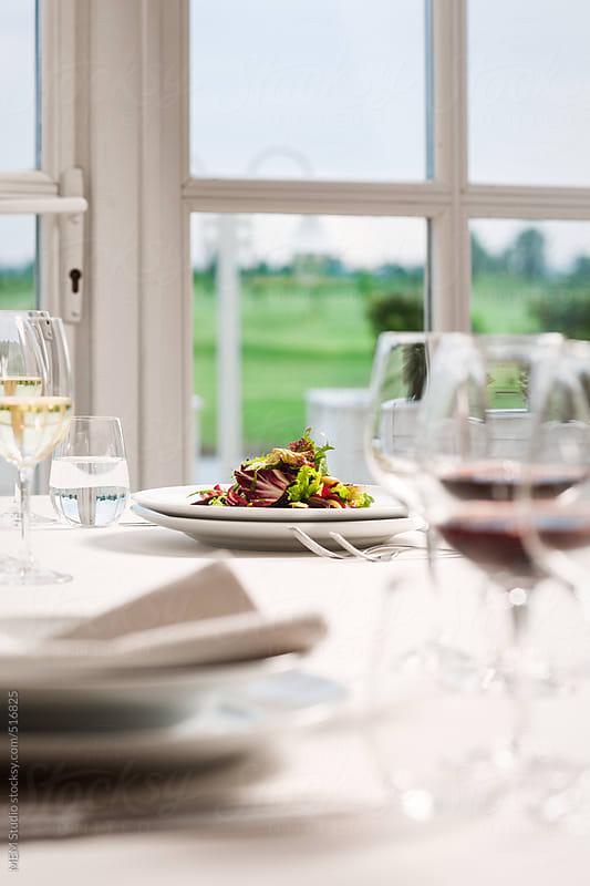 Dinner table at golf club by MEM Studio for Stocksy United