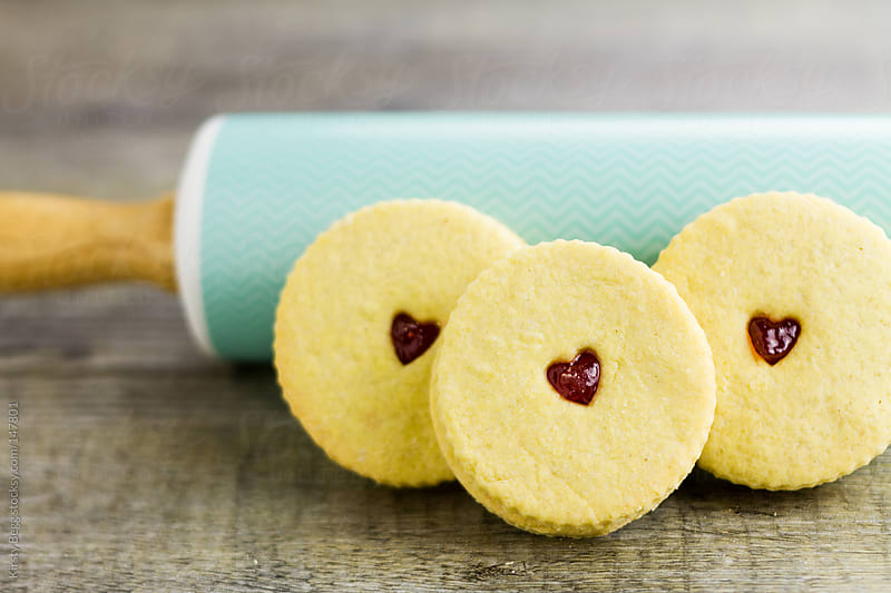 Jam heart biscuits against rolling pin by Kirsty Begg for Stocksy United