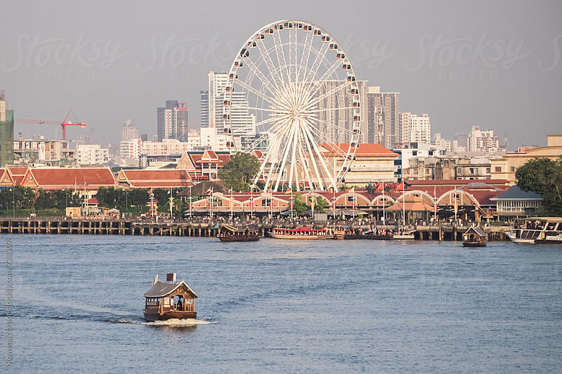 Looking across the river to Asiatique Night Market, Bangkok by Rowena Naylor for Stocksy United