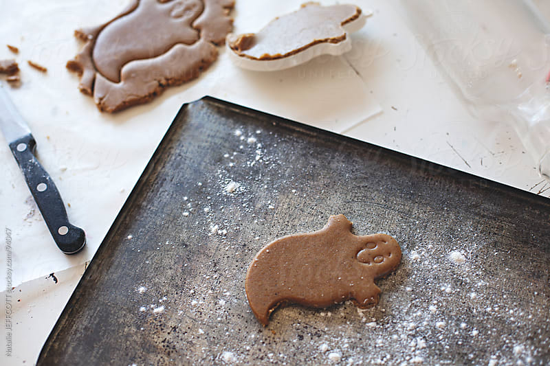 Gingerbread ghost cookie awaits baking for Halloween by Natalie JEFFCOTT for Stocksy United