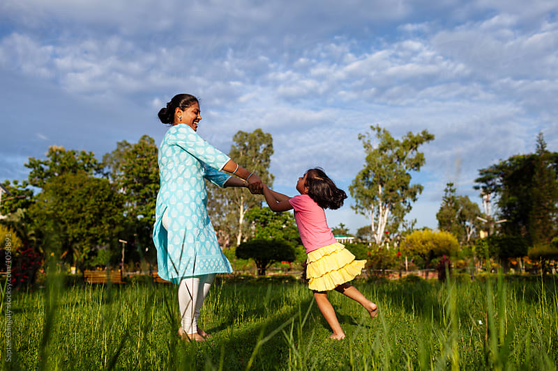 Mother and daughter having fun in the park by Saptak Ganguly for Stocksy United