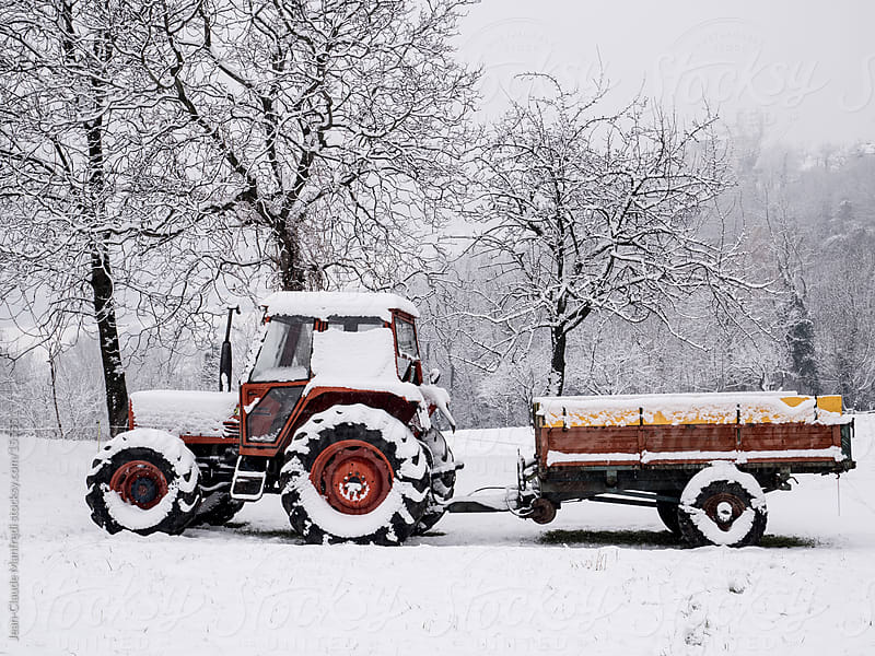 Tractor covered in snow during winter by Jean-Claude Manfredi for Stocksy United