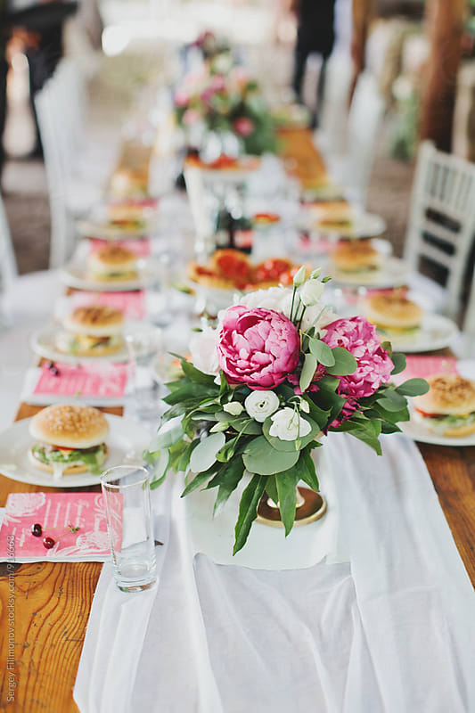 Dinner party for friends by Sergey Filimonov for Stocksy United