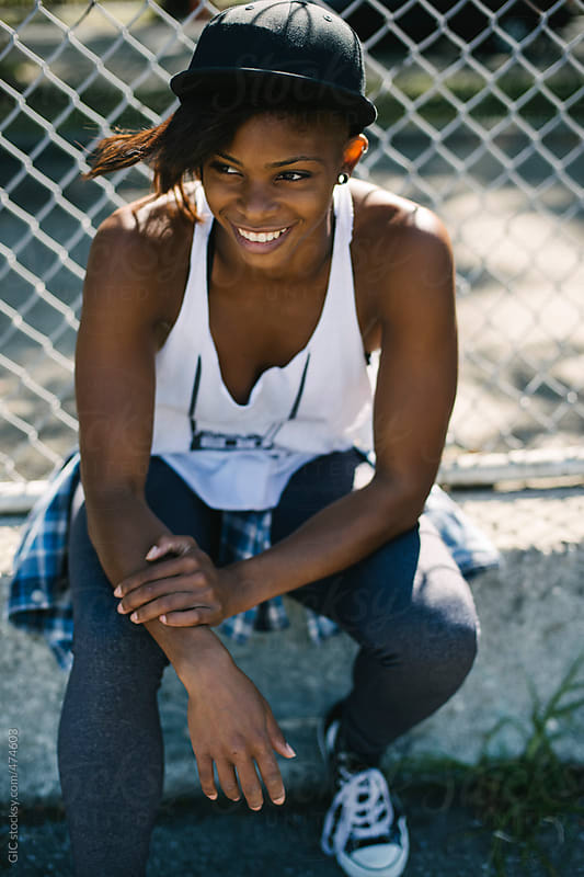 Happy young black woman portrait i urban area by GIC for Stocksy United