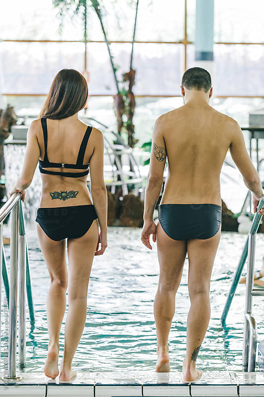 Couple Entering the Pool in a Spa Center by VICTOR TORRES for Stocksy United