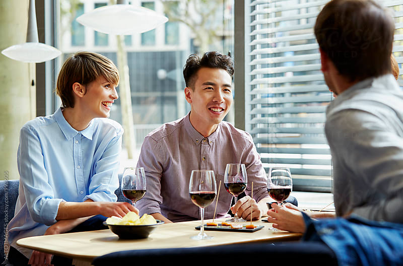 Happy Friends With Wine Glasses In Restaurant by ALTO IMAGES for Stocksy United