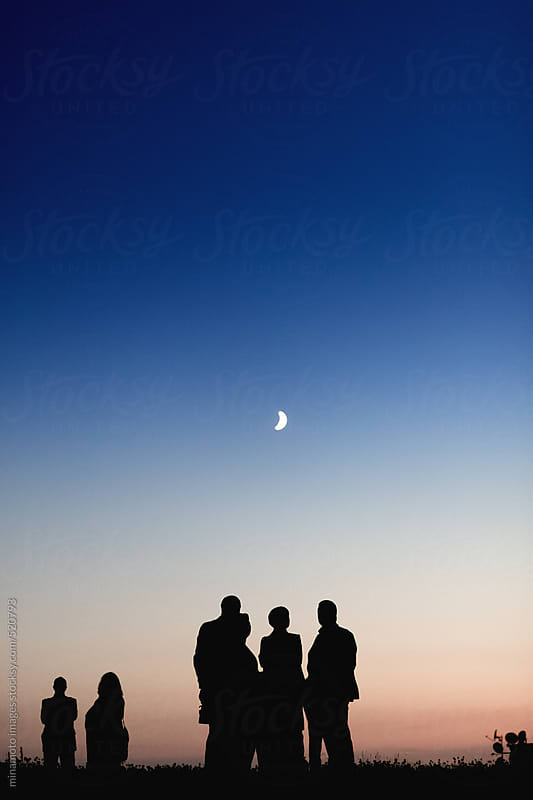 Group of Business People Standing On Meadow At Night by minamoto images for Stocksy United