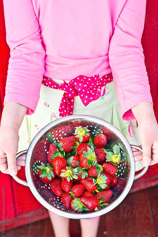 strawberries in hand by Gillian Vann for Stocksy United