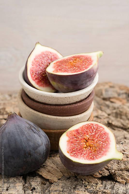 Fresh figs in bowls by Elisabeth Coelfen for Stocksy United