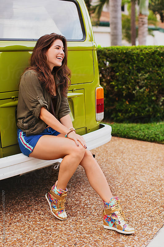 Girl leaning against a van by Ellie Baygulov for Stocksy United