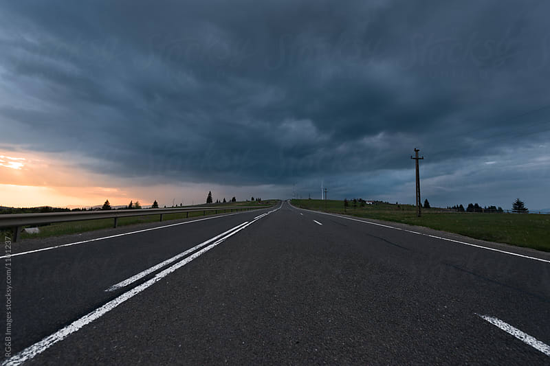 Storm clouds over the road  by RG&B Images for Stocksy United