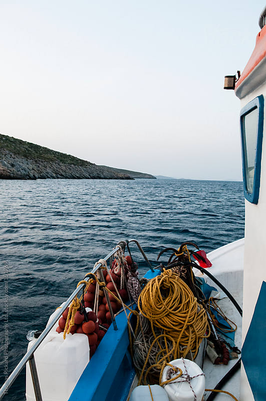 Commercial fishing boat and sea, Fourni Islands, Aegean Sea, Gre by Thomas Pickard for Stocksy United