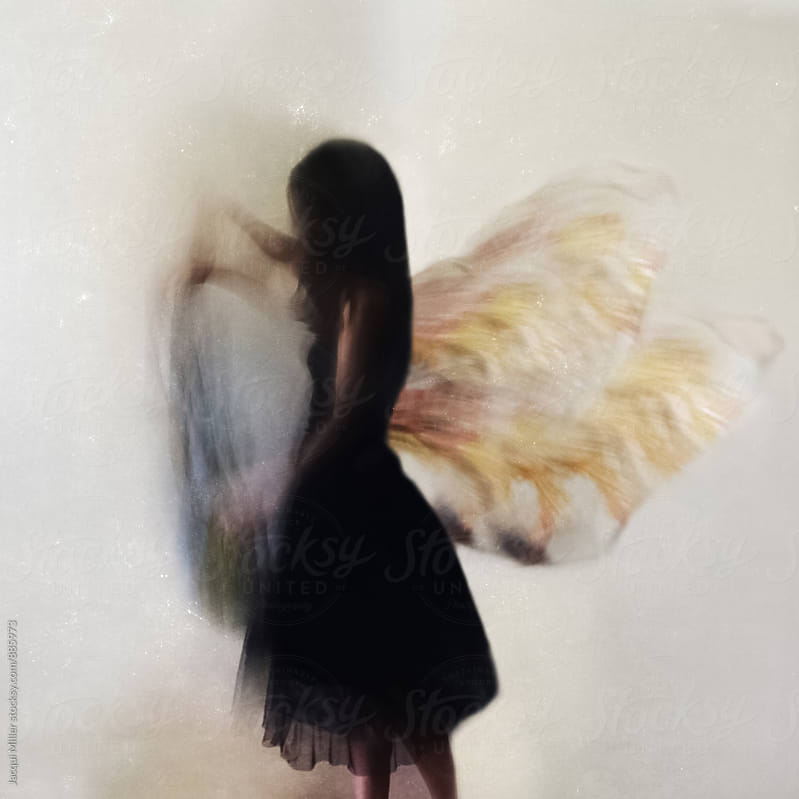 Conceptual - Woman with butterfly wings by Jacqui Miller for Stocksy United