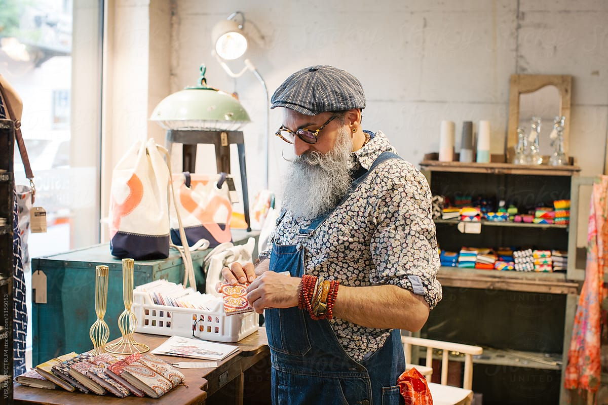 Fashionable Elderly Hipster With Grey Beard Looking at