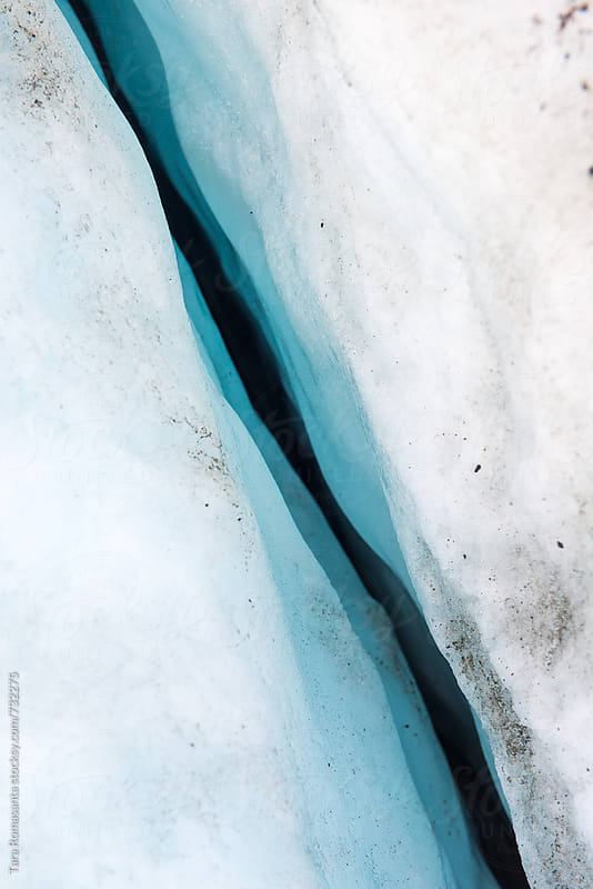 crevasse in a glacier by Tara Romasanta for Stocksy United