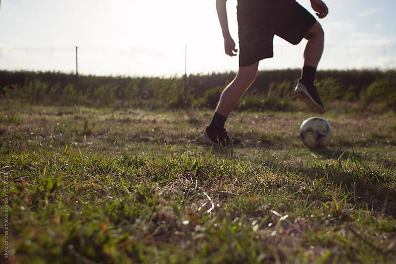 Summer training football soccer by skye torossian for Stocksy United